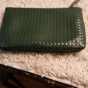 Cosmetics bag  in green faux leather